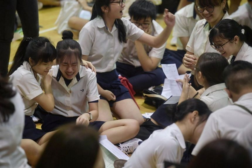Students collecting their O-level results at Xinmin Secondary School on Jan 13, 2020.