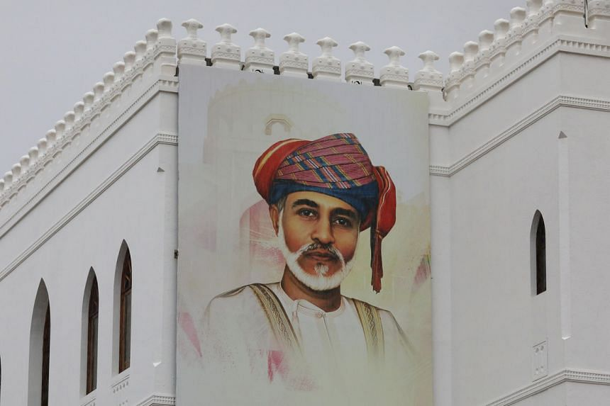 A painting of Oman's Sultan Qaboos bin Said on a building in Muscat. The long-time monarch died last Friday, aged 79, after suffering for years from an undisclosed illness.