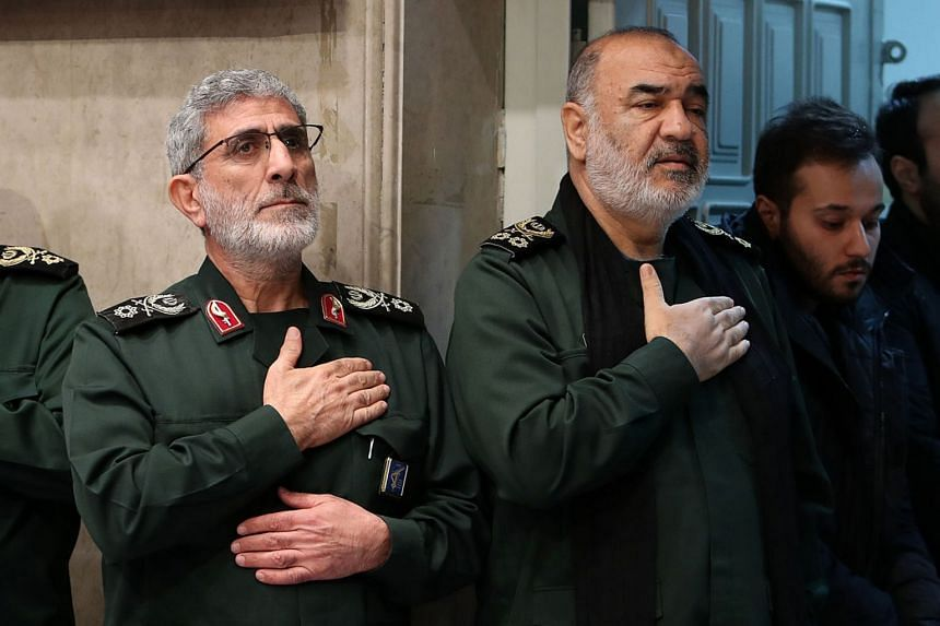 Salami (right) attends a mourning ceremony for slain top general Qasem Soleimani, with newly-appointed commander of the Quds Force of the Islamic Revolutionary Guard Corps Esmail Qaani (left).