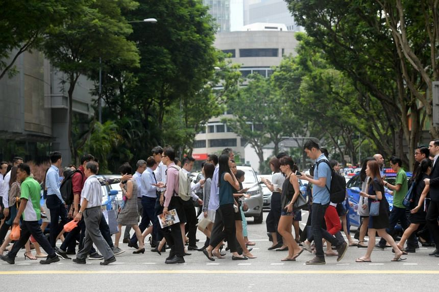 A lunch crowd in Singapore's central business district.