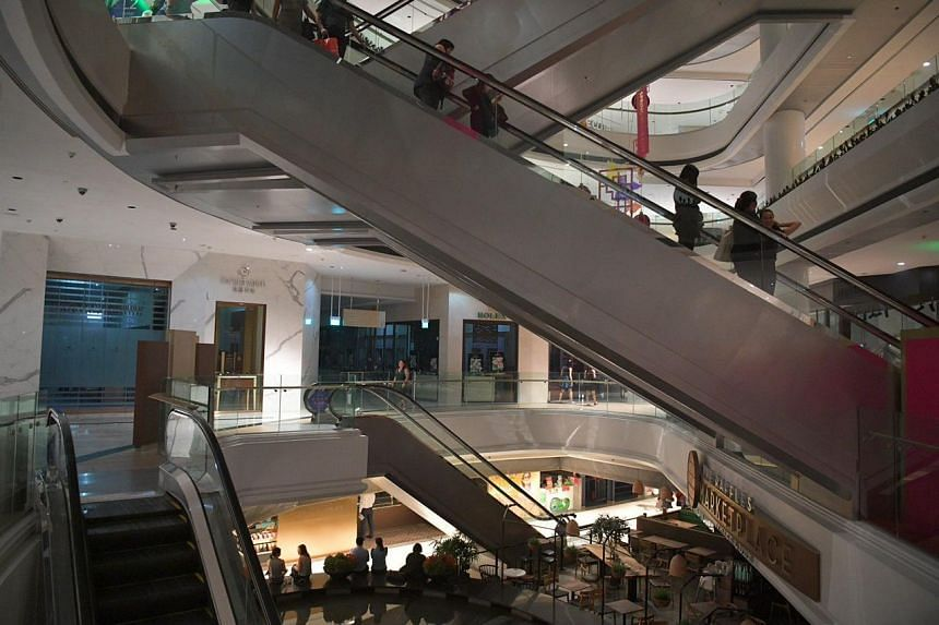 """Raffles City said in a Facebook post at 8.14pm that it was alerted to the """"partial power outage"""" at about 8pm, and was working to restore supply."""