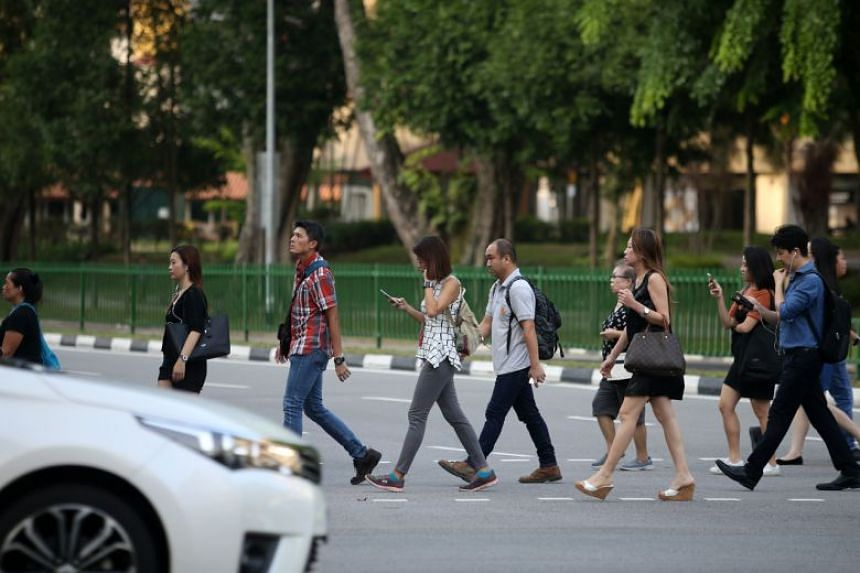 Pedestrians have been reminded by the police to avoid using mobile communication devices while crossing roads and to obey traffic signs and rules.