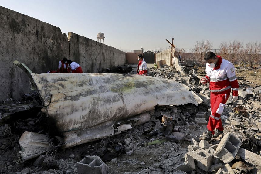 Rescue workers searching the crash site of the downed plane in Shahedshahr, south-west of Iran's capital Teheran, last Wednesday.
