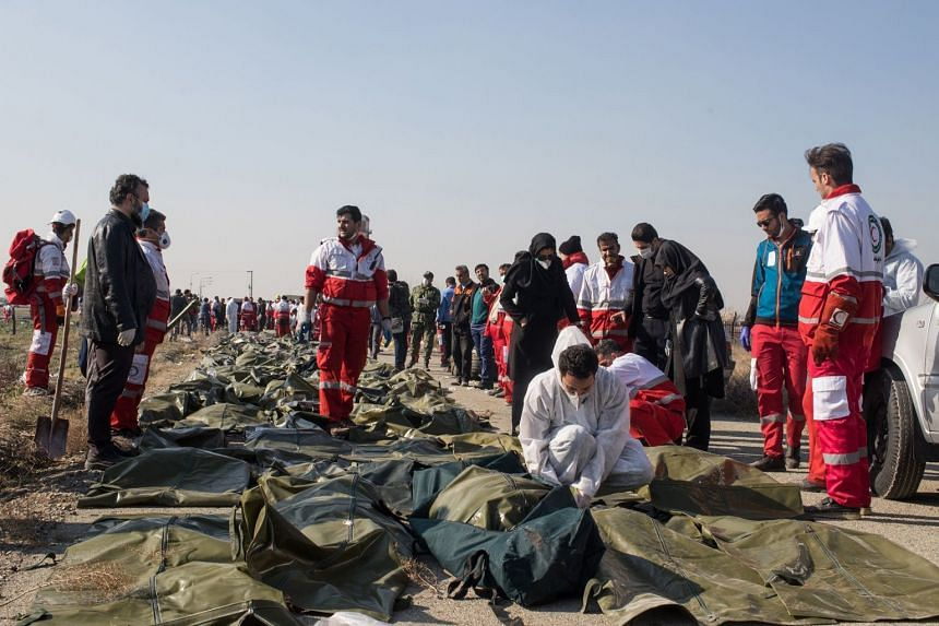 Victims' remains are covered near the crash site on the outskirts of Teheran on Ja. 8, 2020.
