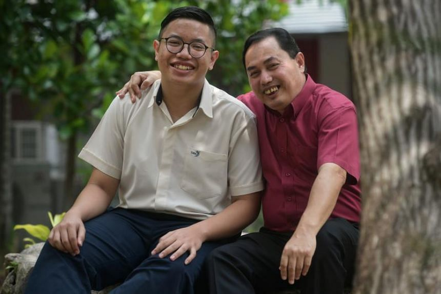 Student Aqil Nasran with his father Nizam Shah Abdul at Xinmin Secondary School on Jan 13, 2020.