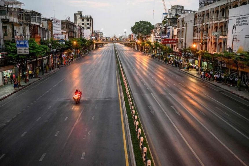 This picture taken on Dec 28, 2019 shows a policeman riding on an empty street which has been blocked due to movements of the royal motorcade.