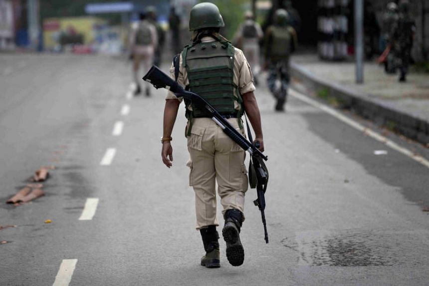 In this file picture, an Indian paramilitary soldier patrols Srinagar, Kashmir, on Aug 15, 2019.