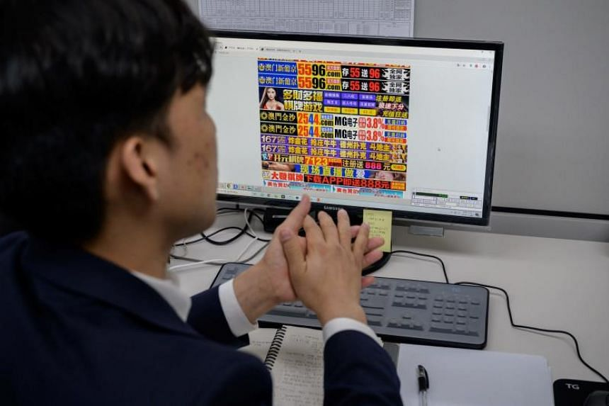 In this picture taken on Nov 8, 2019, an employee works in the office of the Korea Communications Standards Commission in Seoul tasked with hunting down and removing internet sex videos posted without consent.