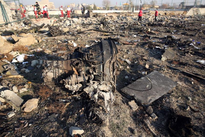 One of the engines of the plane lies among the wreckage after a Ukraine International Airlines Boeing 737-800 crashed in Shahriar, Iran, on Jan 8, 2020.
