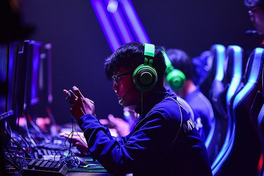 A Myanmar player intently focused on their phone screens during the Mobile Legends Bang Bang competition against Thailand at the 30th SEA Games in Manila last month.