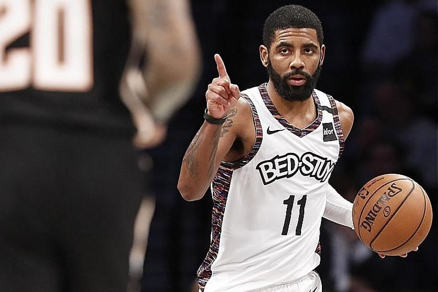 Brooklyn Nets guard Kyrie Irving bringing the ball down the Barclays Centre court against the Atlanta Hawks on Sunday. He played 20 minutes on his return from injury and finished with a game-high 21 points.