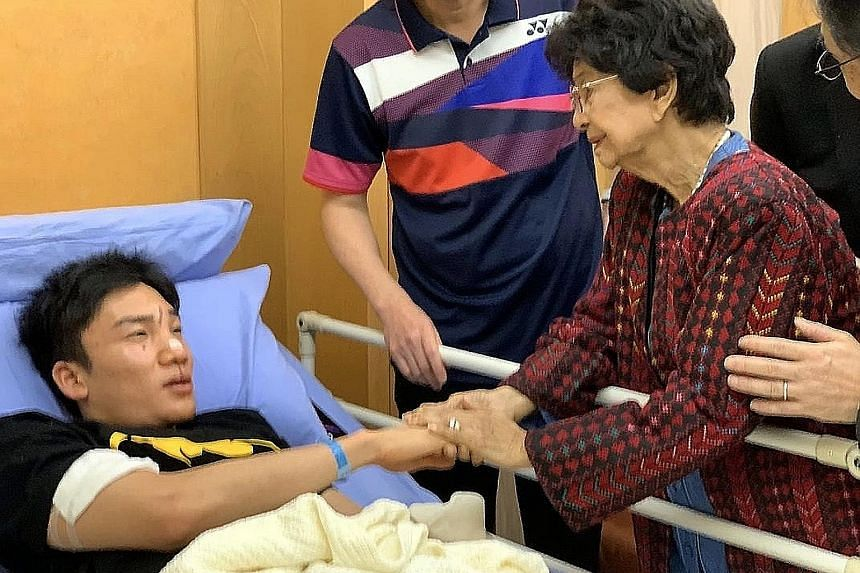 Tun Dr Siti Hasmah Mohamad Ali, wife of Malaysian Prime Minister Mahathir Mohamad, visiting Momota in Putrajaya Hospital. PHOTO: BERNAMA Rescuers at the scene of the accident yesterday, in a handout photo from the Malaysia Fire and Rescue Department.