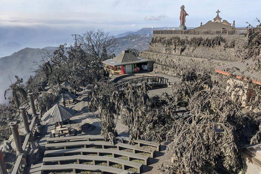 Ashfall in Tagaytay City, in the Philippine province of Cavite, yesterday after the eruption of the Taal volcano. Schools and government offices near the volcano were closed, and thousands were evacuated. PHOTO: REUTERS