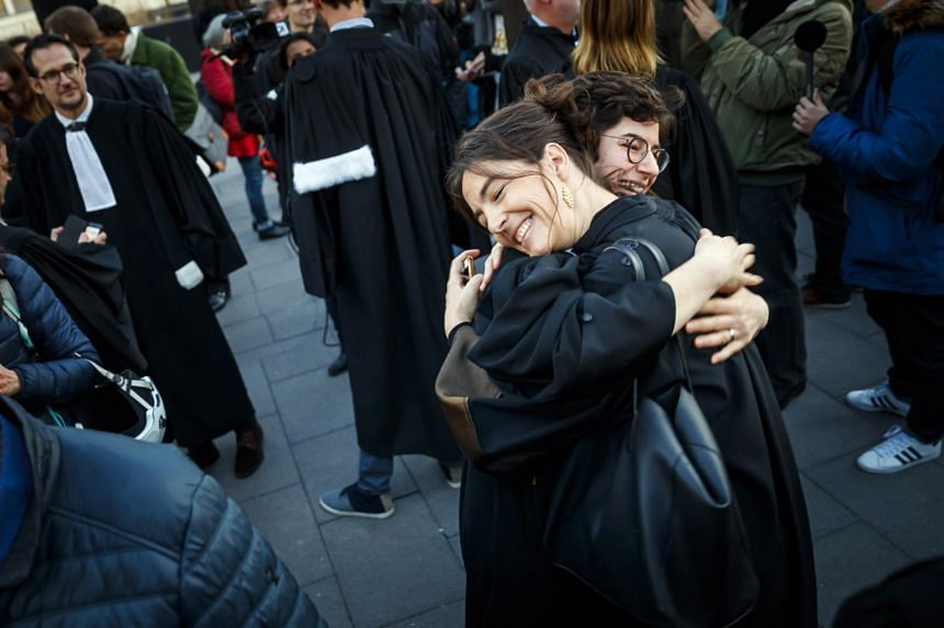 Lawyers Laila Batou (left) and Marie-Pomme Moinat celebrate the non-guilty verdict of the trial of 12 pro-climate activists in Switzerland on Jan 13, 2020.