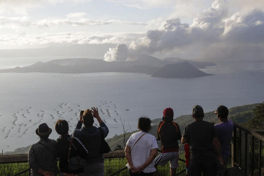 People in Tagaytay, Cavite province, south of Manila, watching Taal Volcano spewing ash on Jan 14, 2020.