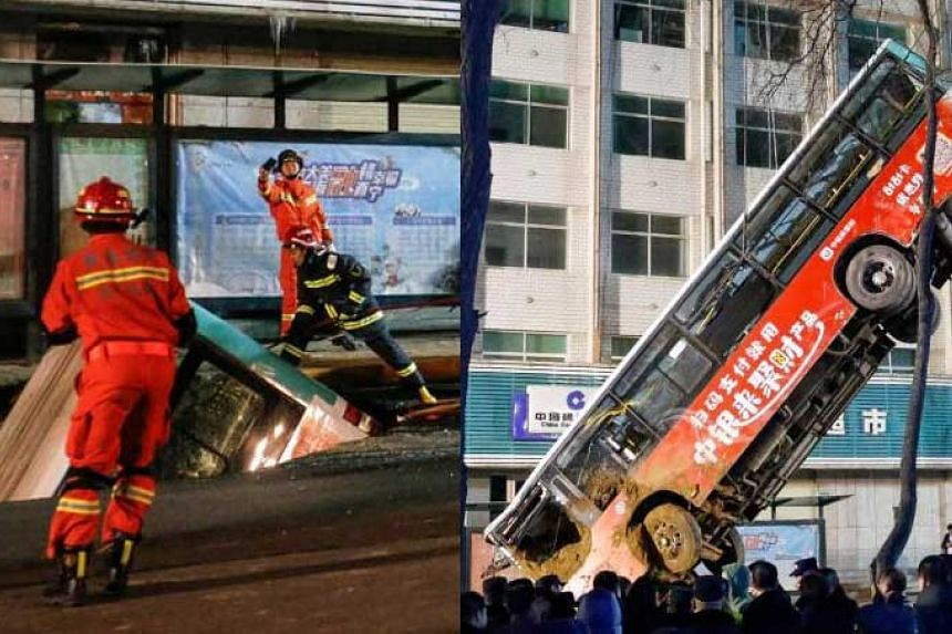 Chinese rescuers lifting out a bus after it was swallowed by a sinkhole in China's northwestern Qinghai province, on Jan 13, 2020.