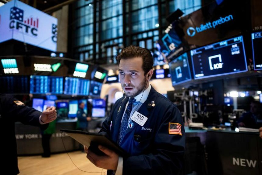 Traders work during the opening bell at the New York Stock Exchange on Jan 13, 2020 on Wall Street.