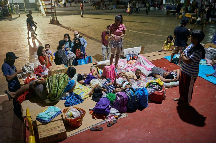 Evacuated residents seek shelter at a gymnasium in Santo Tomas, Philippines, as the Taal volcano erupts on Jan 13, 2020.