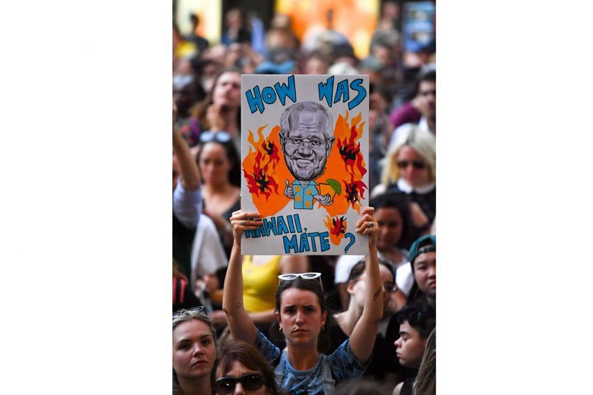 Protesters at a climate change rally in Sydney last week making clear their opinion of Australia's Prime Minister Scott Morrison.