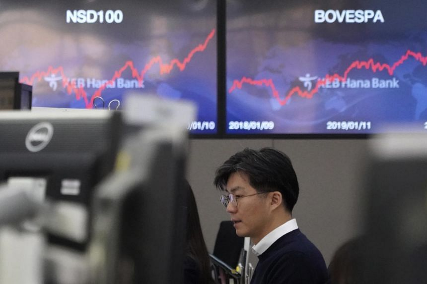 A currency trader watches computer monitors at the foreign exchange dealing room in Seoul on Jan 13, 2020.