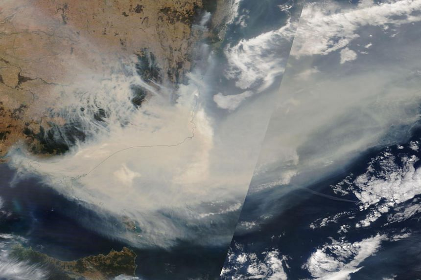 A handout satellite image made available by NASA shows thick smoke moving into the Tasman Sea from the states of New South Wales and Victoria on Jan 3, 2020.