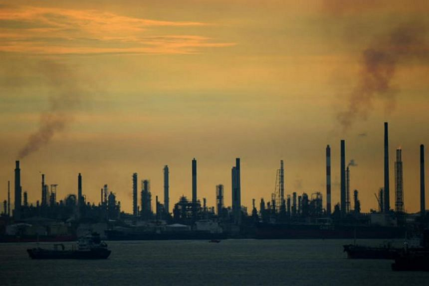 In a photo taken on Jan 2, 2017, an oil refinery at Pulau Bukom can be seen from Sentosa.