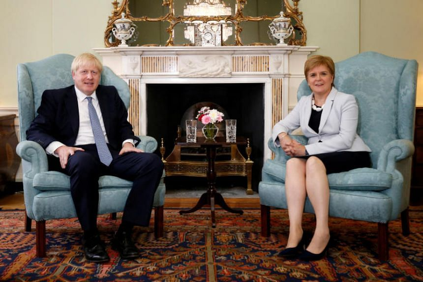 In a photo taken on July 29, 2019, Britain's Prime Minister Boris Johnson meets Scotland's First Minister Nicola Sturgeon at Bute House in Edinburgh, Britain.