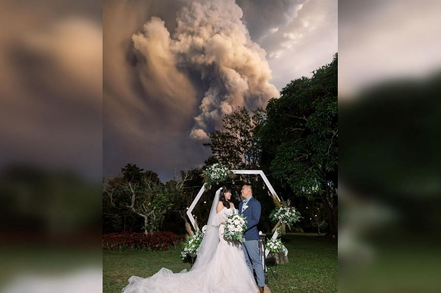 Chino and Kat Palomar exchanged vows in Cavite province on Jan 12, 2020, under a gigantic cloud of smoke and ash from Taal.