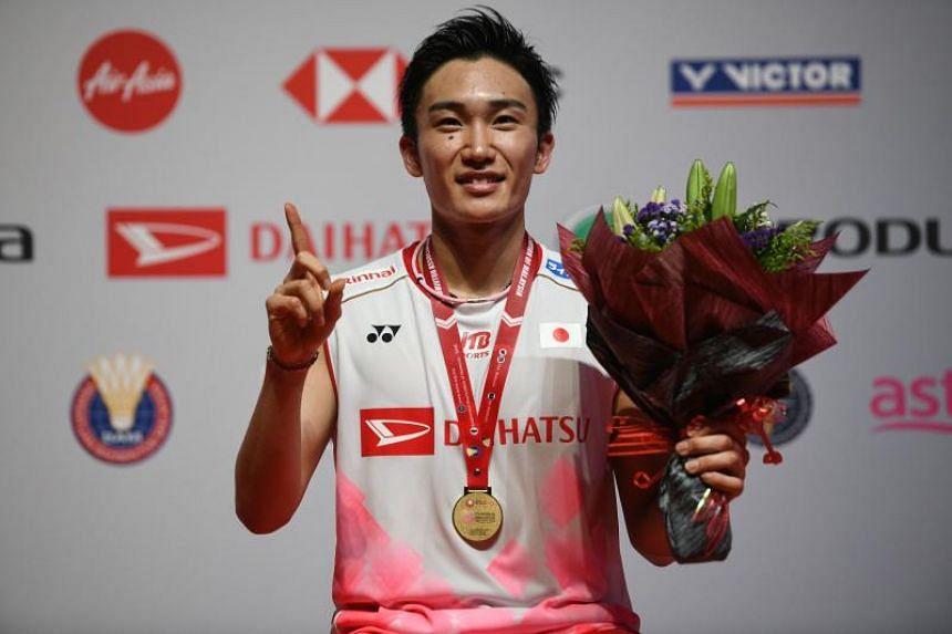 Japan's Kento Momota is seen during an award presentation after winning a match against Denmark's Viktor Axelsen in Kuala Lumpur on Jan 12, 2020.