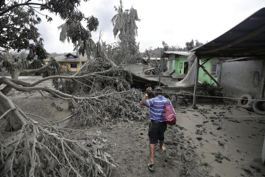 A resident inspects damage to his house from volcanic ash in Batangas province, Philippines, on Jan 14, 2020.