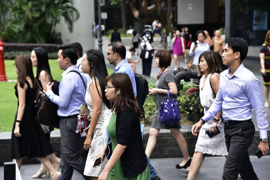 Office workers are seen at Raffles Place on Jan 13, 2020.