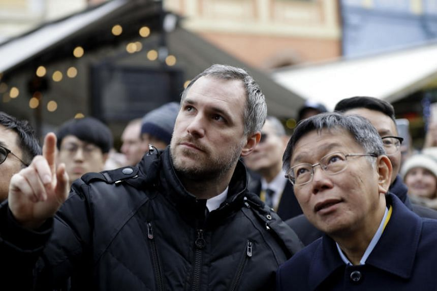 Mayor of Prague Zdenek Hrib (left) and Taipei Mayor Ko Wen-je watching the historical astronomical clock on Jan 13, 2020, before signing a partnership agreement between the two cities at the Old Town Square in Prague, Czech Republic.