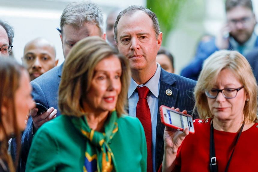 Democrats Adam Schiff and Nancy Pelosi are followed by reporters after a meeting to discuss transmitting the articles of impeachment.