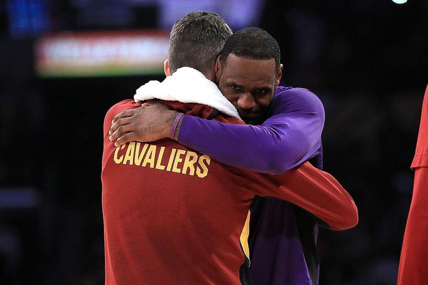 LeBron James and former teammate Kevin Love sharing an embrace. Dwight Howard swinging from the rim after a dunk against the Cleveland Cavaliers. The Lakers centre had a season-high 21 points to go with 15 boards in a blowout 128-99 win.