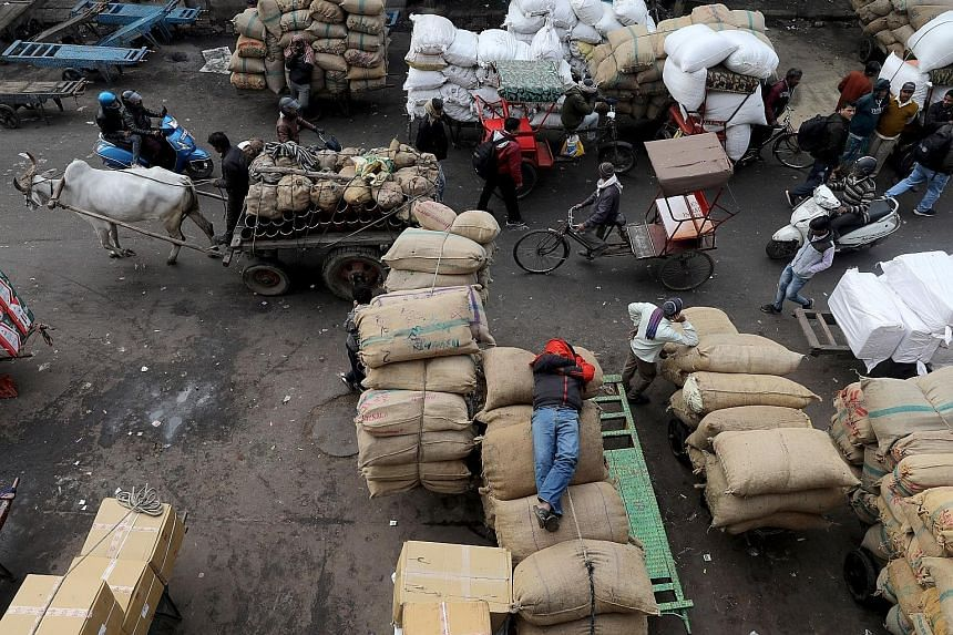 A wholesale market in the old quarters of Delhi on Jan 7. At the heart of India's problems is a slump in consumption following a combination of policy missteps,