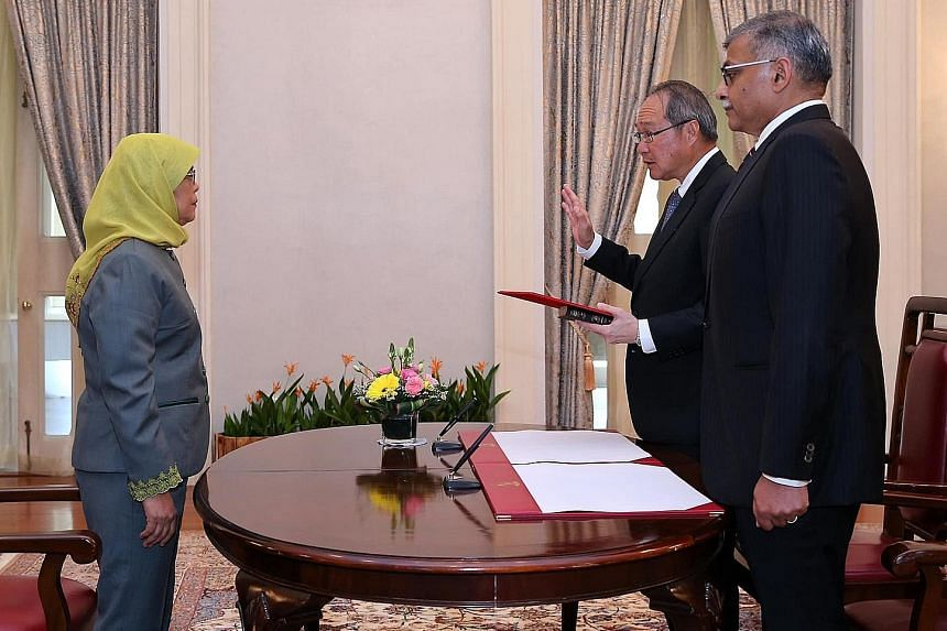 Attorney-General Lucien Wong was reappointed and sworn in at the Istana yesterday in a ceremony officiated by President Halimah Yacob. Next to him is Chief Justice Sundaresh Menon. Mr Wong, who is Singapore's ninth Attorney-General, has served as the