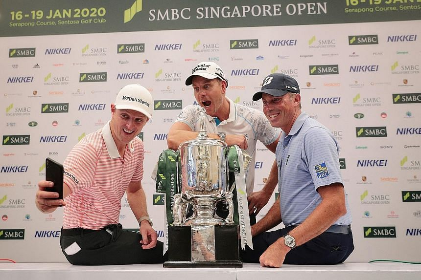 (From left) Justin Rose, Henrik Stenson and Matt Kuchar, who are expected to lead the charge for honours at this week's SMBC Singapore Open, taking a wefie yesterday. ST PHOTOS: JASON QUAH