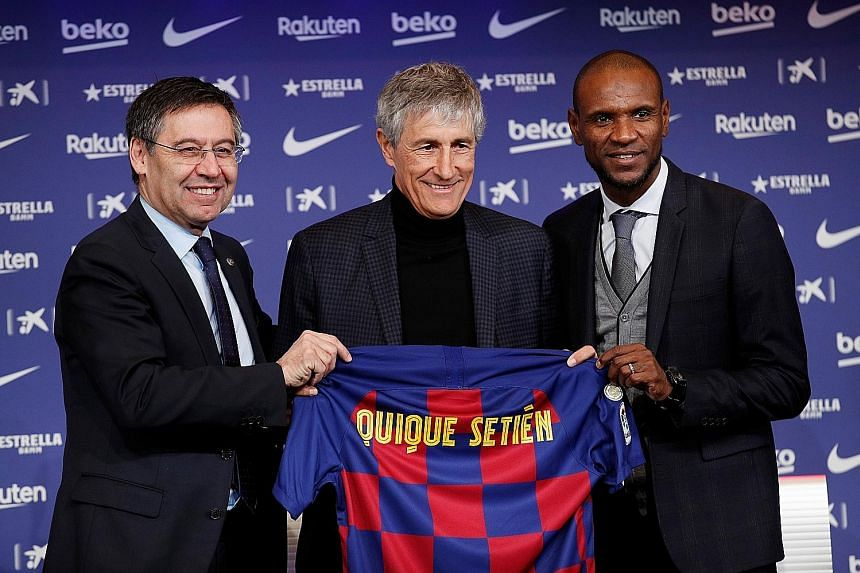 Above: Quique Setien is flanked by his new employers, club president Josep Maria Bartomeu (left) and director of football Eric Abidal. Right: Ernesto Valverde will depart the Nou Camp with his team atop La Liga. PHOTOS: REUTERS