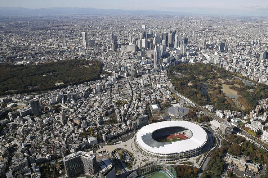 An aerial view shows the new National Stadium, the main stadium of Tokyo 2020 Olympics and Paralympics, in Tokyo, on Nov 30, 2019.