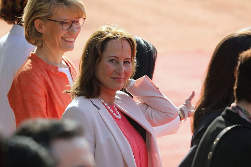 A 2018 photo shows Segolene Royal (centre) at a ceremonial reception in India.
