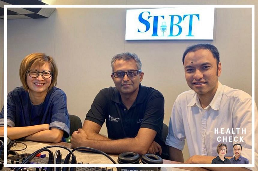 ST correspondent Joyce Teo (left) and podcasting head Ernest Luis (right) host Dr Dinesh Sirisena (centre), who is a consultant at the sports medicine department of Khoo Teck Puat Hospital on this episode of Health Check.