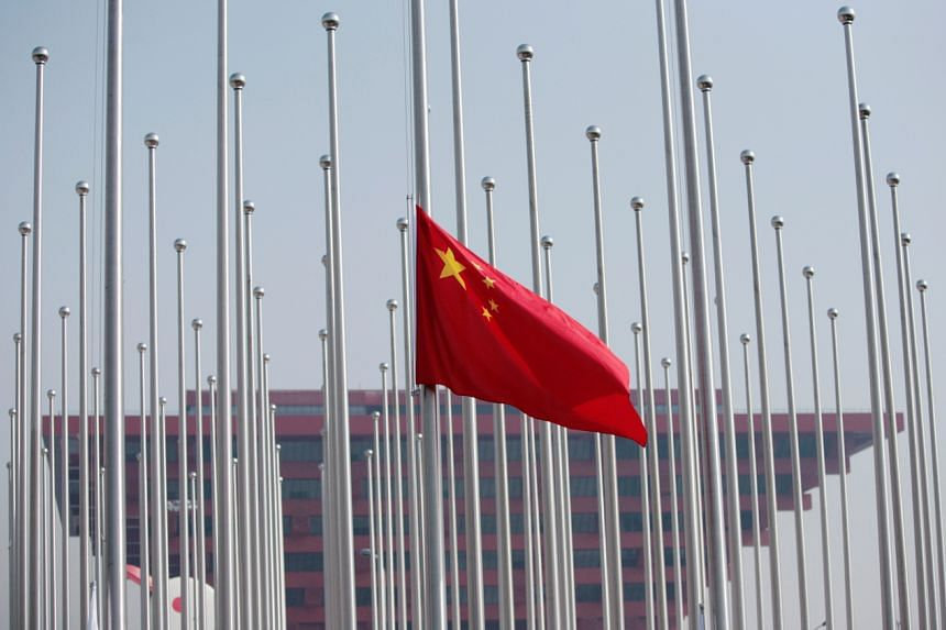 In a photo taken on April 30, 2010, the Chinese flag is raised in front of the China Pavilion at the Shanghai World Expo site in Shanghai.