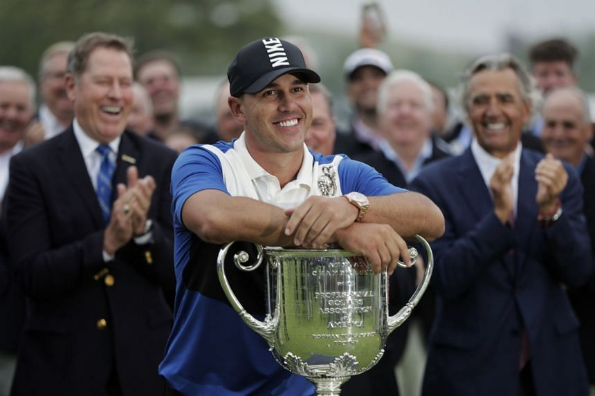 A May 2019 photo shows Brooks Koepka posing with the Wanamaker Trophy after winning the PGA Championship golf tournament.