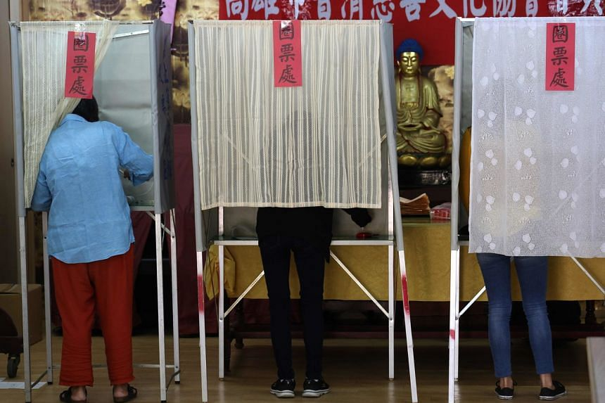 Residents vote at a polling station at Linyuan District in Kaohsiung, on Jan 11, 2020.