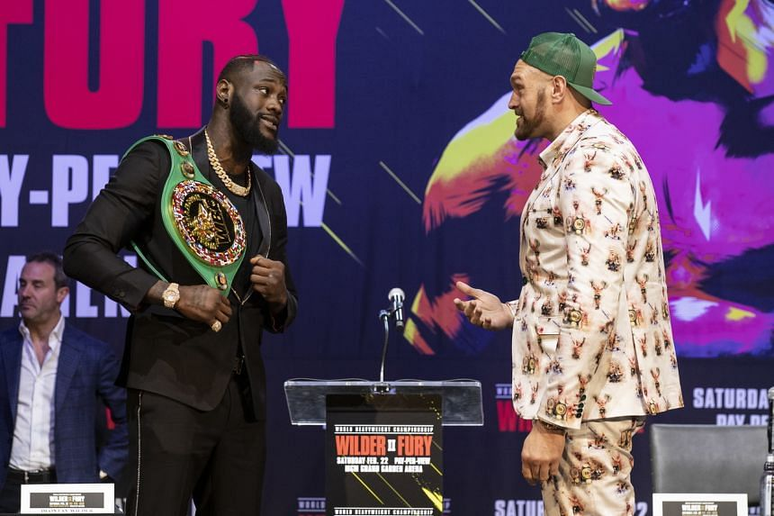 British boxer Tyson Fury (left) and US boxer Deontay Wilder face off prior to their World Heavyweight Championship fight at The Novo Theater in Los Angeles on Jan 13, 2020.