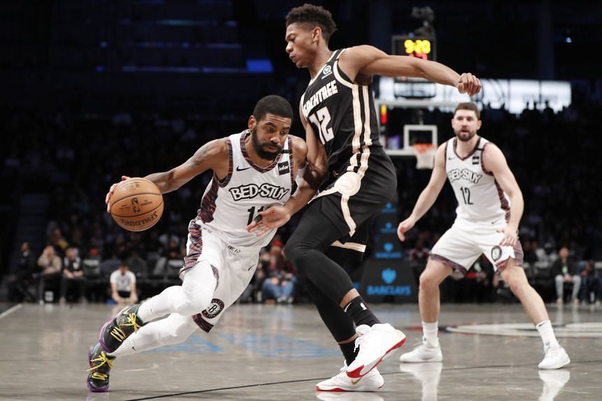 Brooklyn Nets guard Kyrie Irving (11) drives around Atlanta Hawks forward De'Andre Hunter (12) during the second half of an NBA basketball game, on Jan 12, 2020.