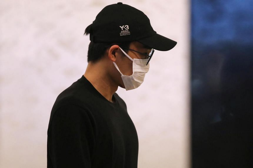 Japanese badminton player Kento Momota arrives at Kuala Lumpur International Airport after he was discharged from hospital, on Jan 15, 2020.