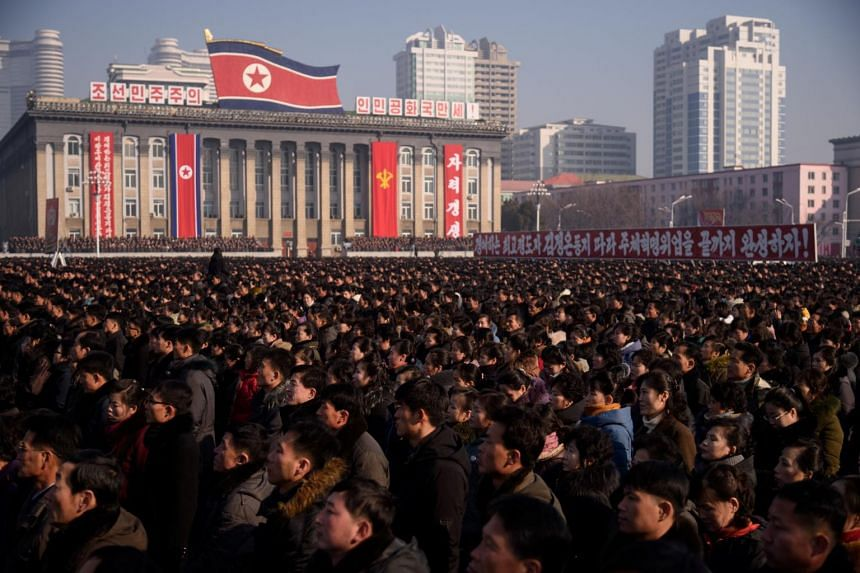 People attend a rally in support of the 5th Plenary Meeting of the 7th Central Committee of the Workers' Party of Korea at Kim Il Sung Square in Pyongyang, on Jan 5, 2020.