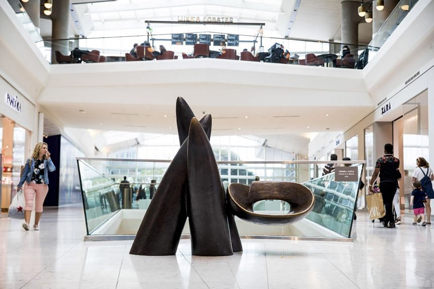 """""""Veiled in a Dream,"""" a sculpture and public seat by Wendell Castle near the food court at the Aventura Mall in Aventura, Florida, on Jan 10, 2020."""