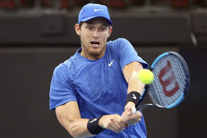 Jarry plays a shot during his match against Dusan Lajovic of Serbia at the ATP Cup tennis tournament in Australia.